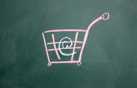 online shopping symbol drawn with chalk on blackboard photo