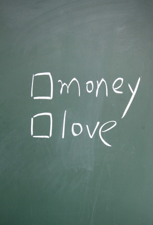 money or love choice written with chalk on blackboard Stock Photo - 13011322
