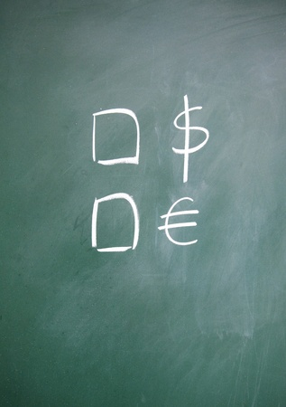 dollar and euro choice symbol drawn with chalk on blackboard Stock Photo - 13011501