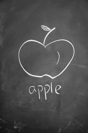 apple symbol drawn with chalk on blackboard photo