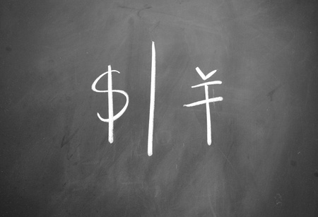 dollar and yuan symbol written with chalk on blackboard photo