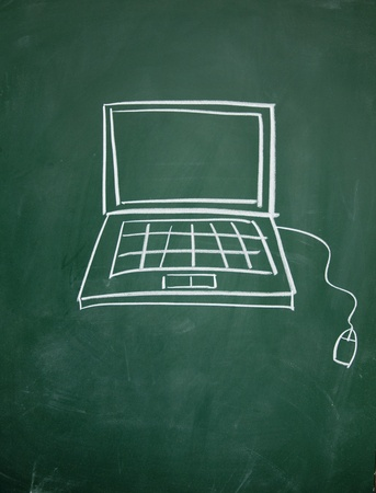 Notebook computer drawn with chalk on blackboard Stock Photo - 13011328