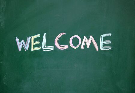 welcome title written with chalk on blackboard Stock Photo - 13011287
