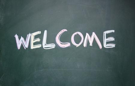 greet: welcome title written with chalk on blackboard