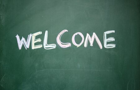 welcome title written with chalk on blackboard Stock Photo - 13011324
