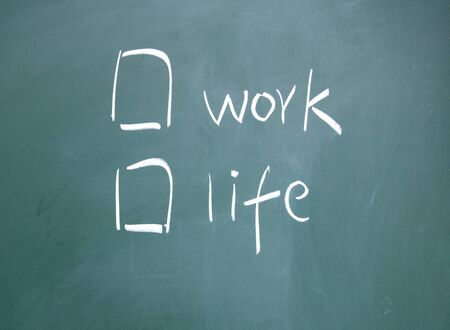 Work or life choice written with chalk on blackboard Stock Photo - 13011316