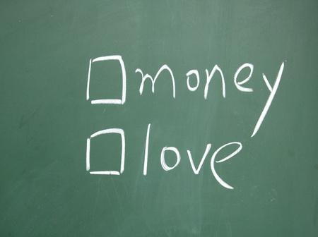 money or love choice written with chalk on blackboard Stock Photo - 13011286