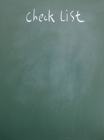 check list title written with chalk on blackboard photo