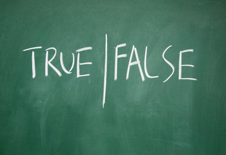 true and false symbol drawn with chalk on blackboard photo