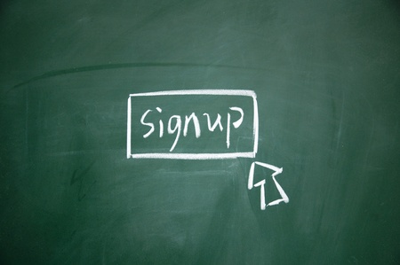 sign up button drawn with chalk on blackboard photo