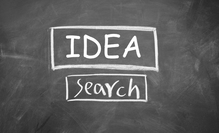 idea search symbol drawn with chalk on blackboard photo