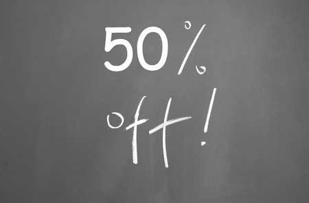 discount symbol drawn with chalk on blackboard Stock Photo - 13320815