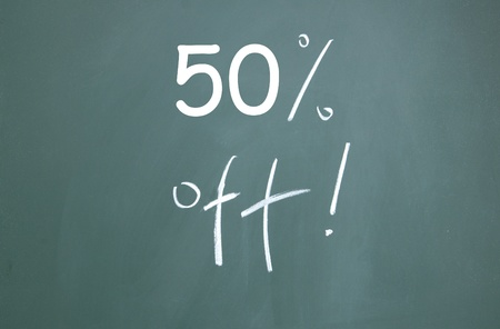 discount symbol drawn with chalk on blackboard photo