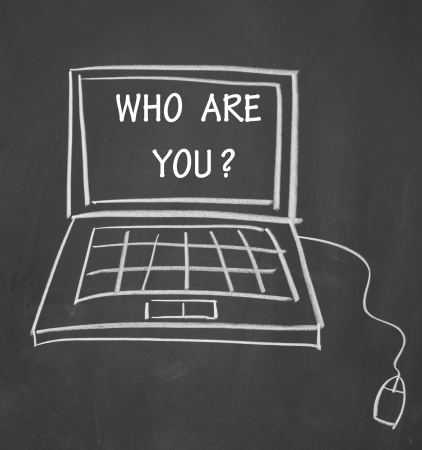 who are you title and notebook computer photo