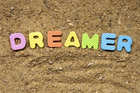 dreamer symbol and sand background photo