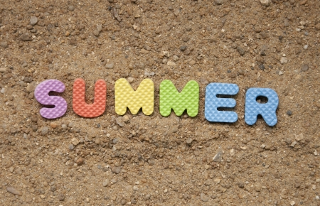summer symbol and sand background photo