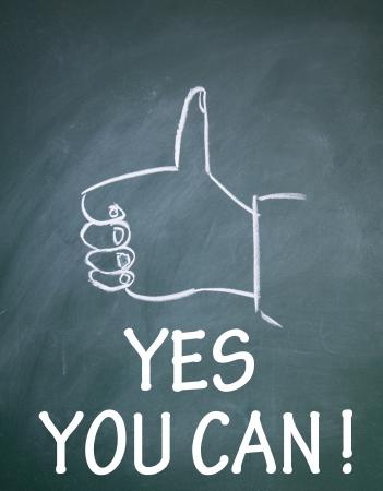 thumb up gesture drawn with chalk on blackboard