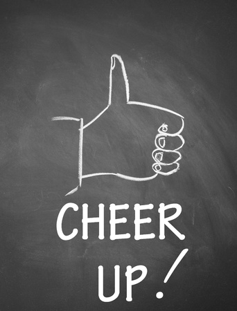 thumb up gesture drawn with chalk on blackboard photo