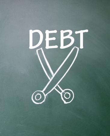 debt collection: cut debt symbol  Stock Photo
