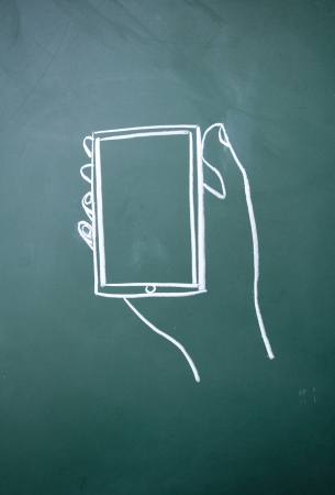 A person holding a cell phone symbol drawn with chalk on blackboard Stock Photo - 14922464