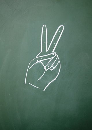 come up to: Victory sign drawn with chalk on blackboard