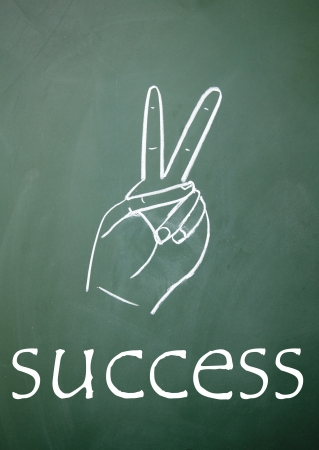 success symbol drawn with chalk on blackboard photo