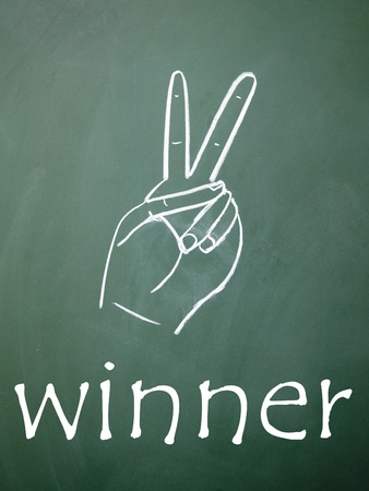 winner symbol drawn with chalk on blackboard photo