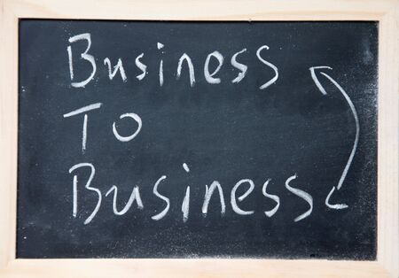 business to business sign written with chalk on blackboard Stock Photo
