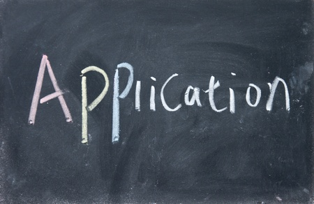 application title written with chalk on blackboard photo