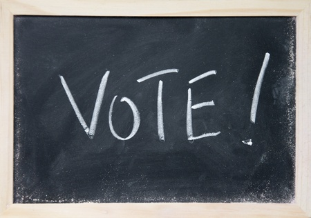 vote title written with chalk on blackboard Stock Photo - 16097893