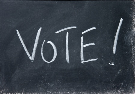 balloting: vote title written with chalk on blackboard