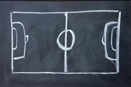 黒板にチョークで描かれた抽象的なフットボール競技場 写真素材