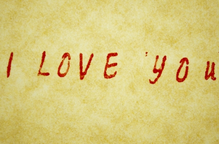 I love you title written with pen on parchment photo