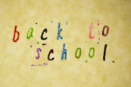 back to school written with pen on parchment photo