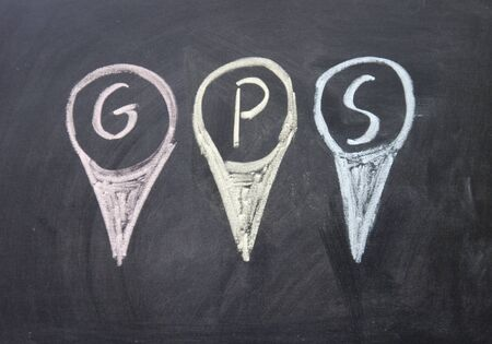 gps sign written with chalk on blackboard photo