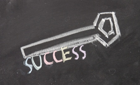 success key drawn with chalk on blackboard photo