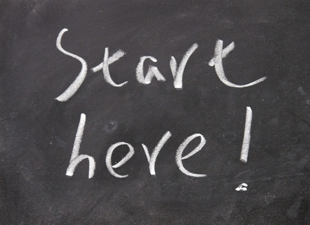 new start: start here title written with chalk no blackboard