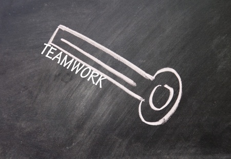 abstract teamwork key drawn with chalk on blackboard Stock Photo - 16613232