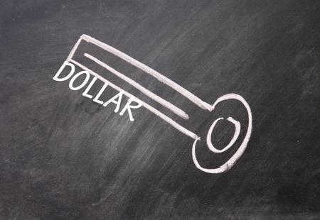 abstract dollar key drawn with chalk on blackboard Stock Photo - 16613199
