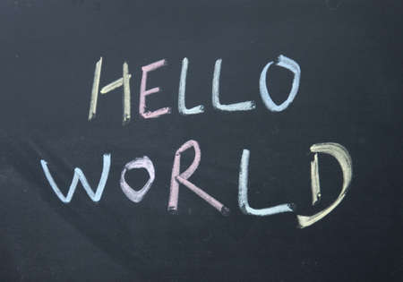 hello world title written with chalk on blackboard photo