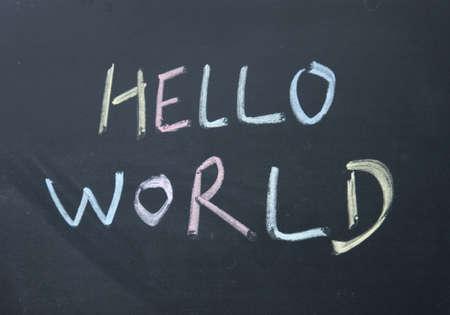hello world title written with chalk on blackboard Stock Photo - 16611277