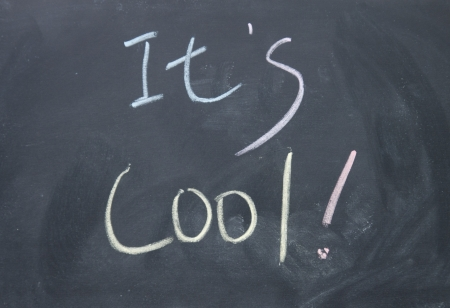 it s cool title  written with chalk on blackboard photo