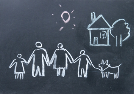 dream house: family sign drawn with chalk on blackboard