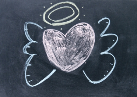 heart angel sign drawn with chalk on blackboard
