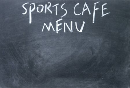 sports cafe menu title written with chalk on blackboard photo