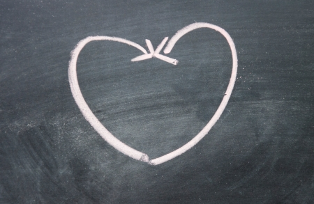 heart sign drawn with arrow on blackboard photo