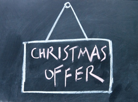 christmas offer board drawn with chalk on blackboard photo