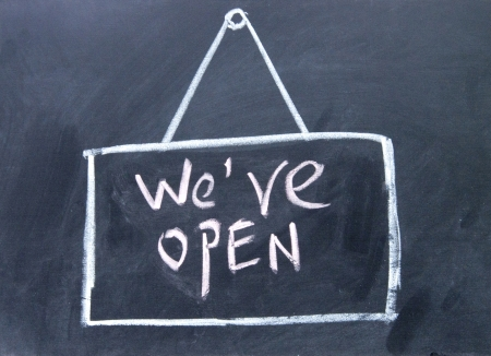 we are open  sign drawn with chalk on blackboard  photo