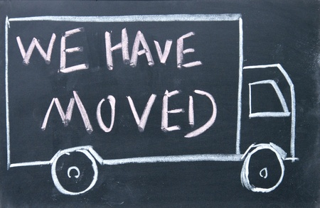 have on: we have moved sign Stock Photo