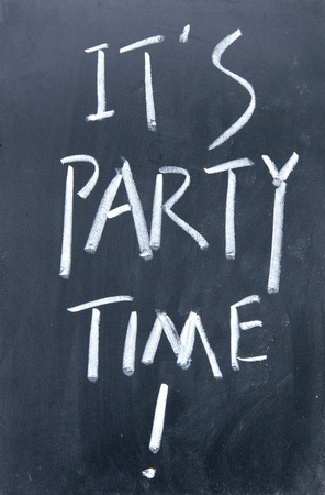 it is party time written with chalk on blackboard photo